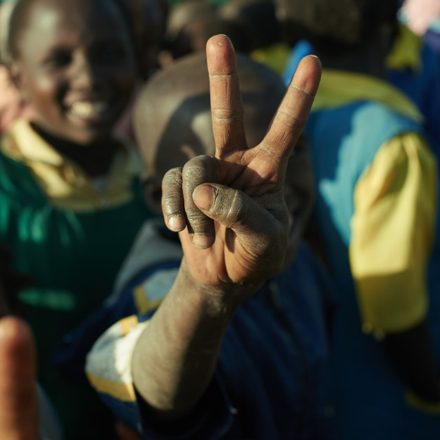 """""""Kid is showing victory sign"""" stock image"""