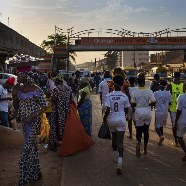 """Bissau, Republic of Guinea-Bissau - January 30, 2018: Street scene in the city of Bissau with people at the Bandim Market, in Guinea-Bissau, West Africa"" stock image"