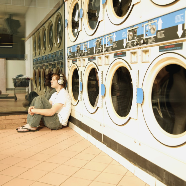 """""""Listening To Music At The Laundromat"""" stock image"""