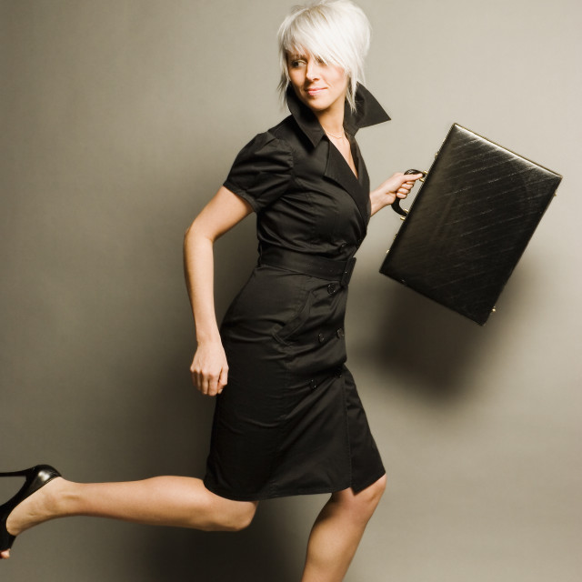 """""""Woman Running While Holding A Briefcase"""" stock image"""