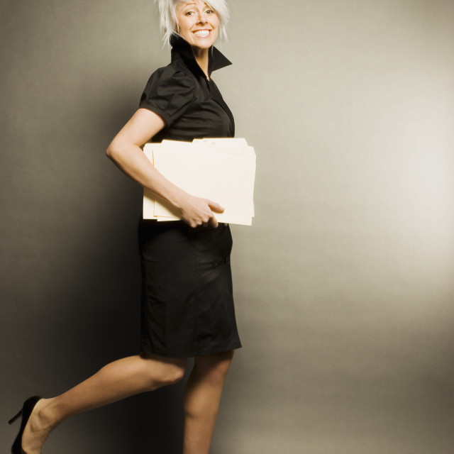 """""""Woman Running With Documents"""" stock image"""