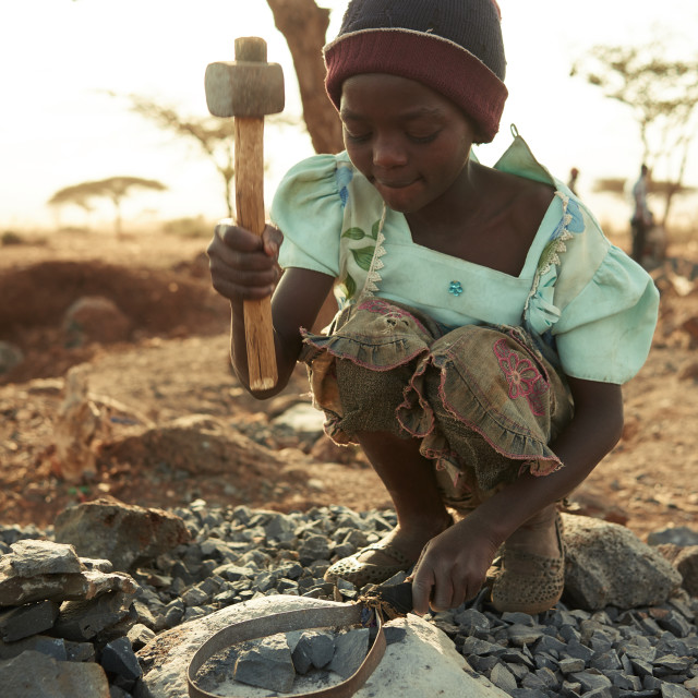 """Girl crushing stones"" stock image"
