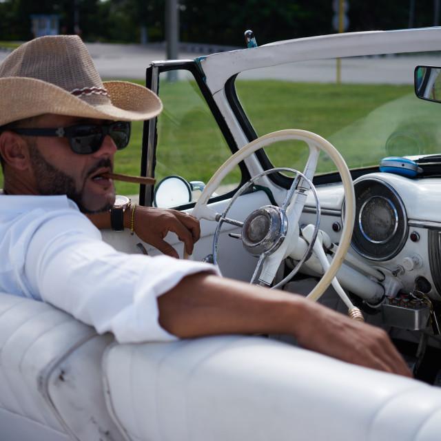 """Cab driver smoking cigar"" stock image"