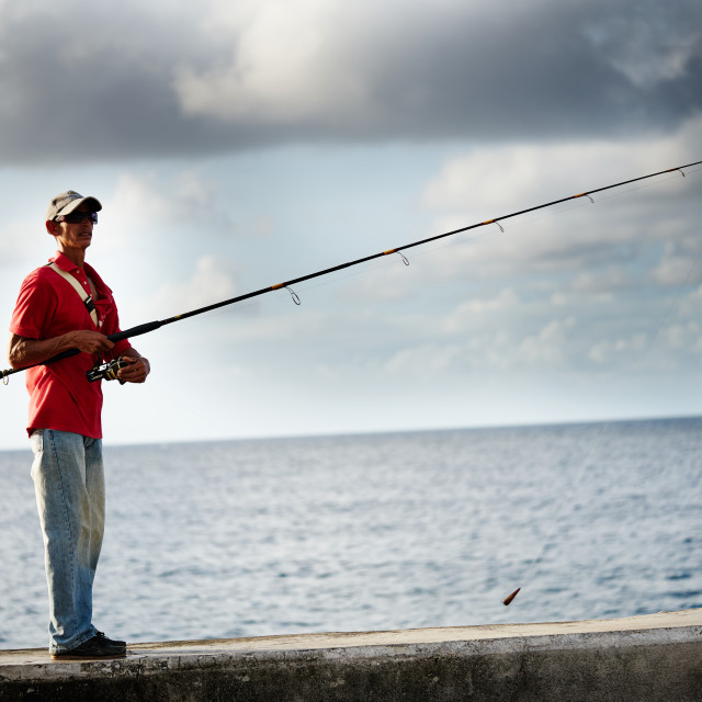 """""""Fisherman trying to catch a fish"""" stock image"""