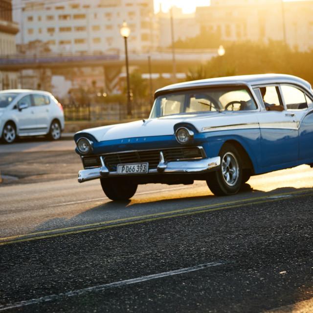 """""""Classic car drives thru El Malecon, Havana Cuba"""" stock image"""