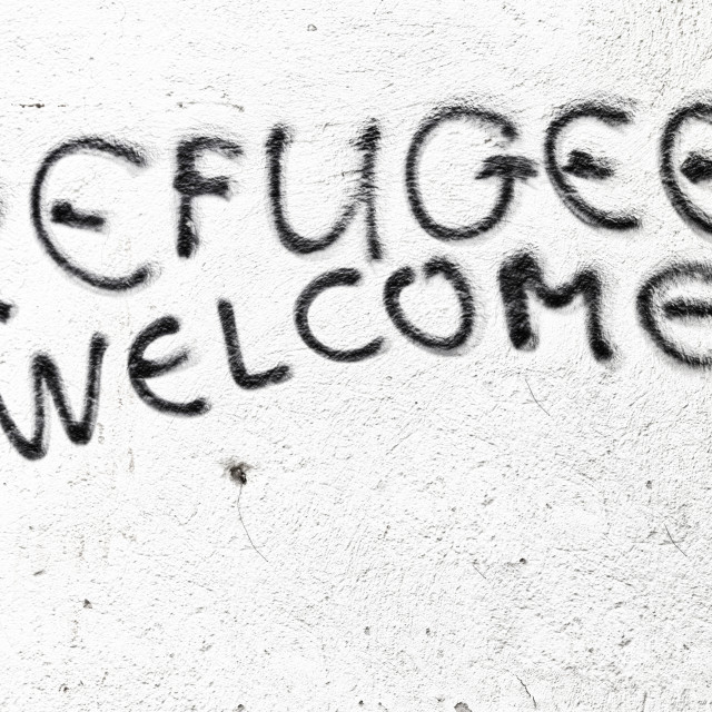 """""""the spray paint in the wall with refugees welcome"""" stock image"""