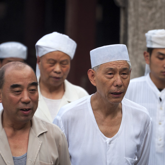 """Xian, China - August 5, 2012: Group of man wearing taqiyah at the Xian Great Mosque in the city of Xian in China, Asia."" stock image"