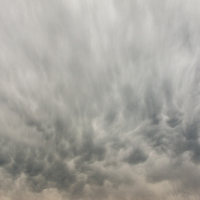"""Streaky clouds during a storm."" stock image"