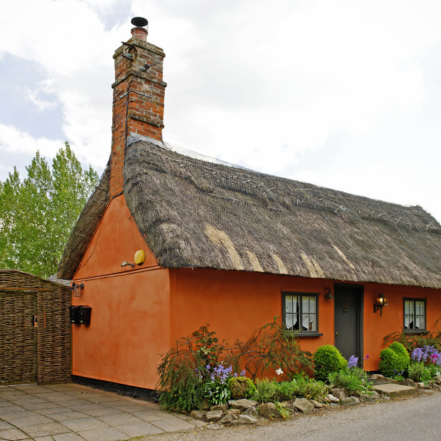 """Historic Thatched Cottage in the UK"" stock image"
