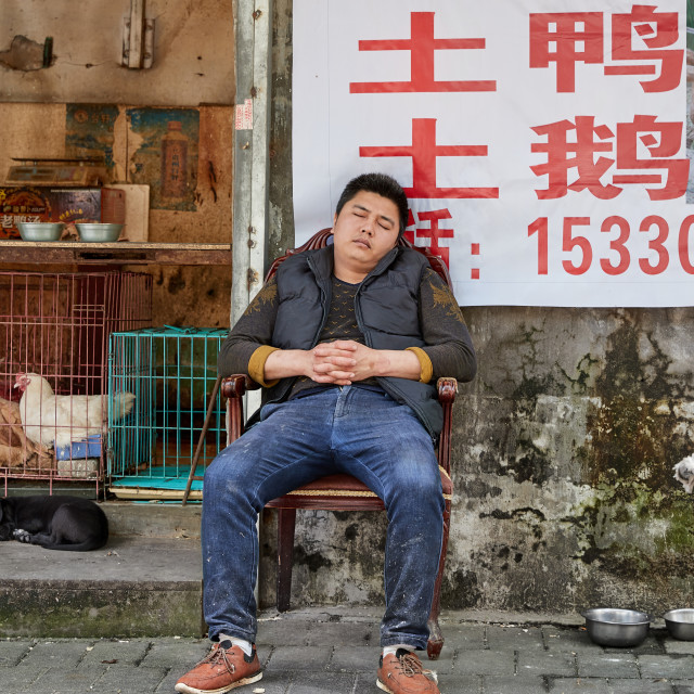 """Sleeping salesman in Chongqing"" stock image"