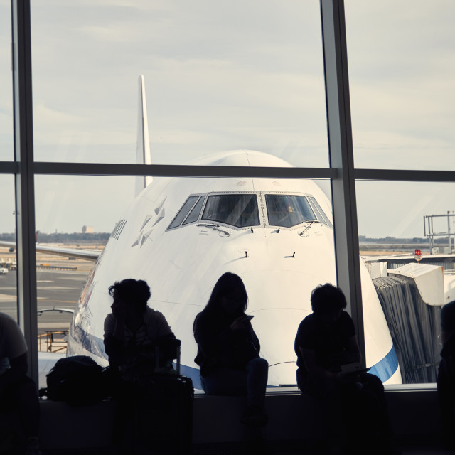 """Passengers waiting to board passenger aircraft"" stock image"