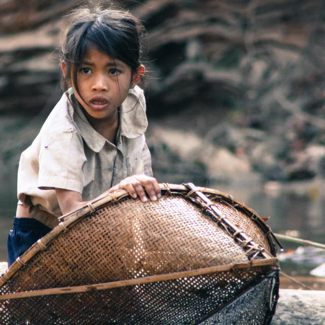 """Young girl fishing - Hin Bun Laos"" stock image"