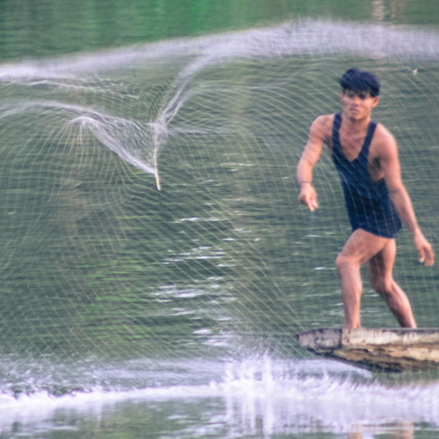 """Casting his net - Si Pan Don Laos"" stock image"