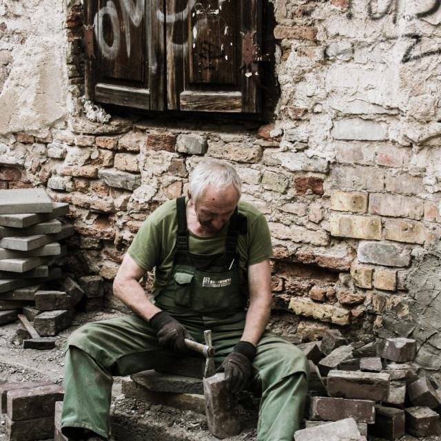 """""""Stone mason - Vilnius, Lithuania"""" stock image"""