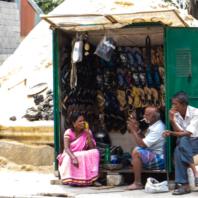 """Chatting at the shoe stall - Bangalore India"" stock image"