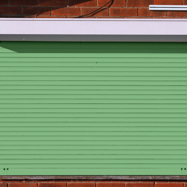 """""""Closed green security shutters"""" stock image"""