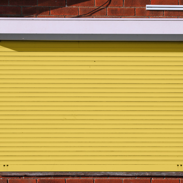 """""""Closed yellow security shutters"""" stock image"""