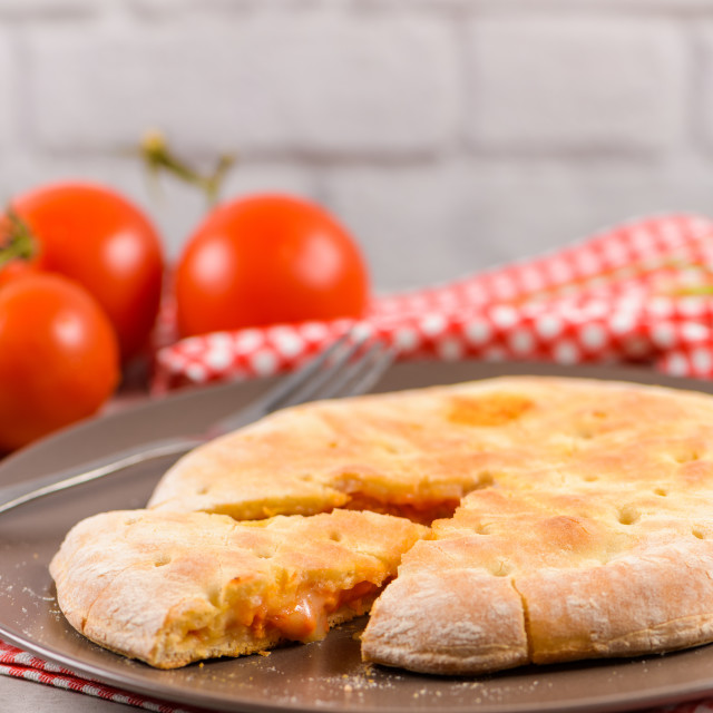 """Pizza calzone on wooden background"" stock image"