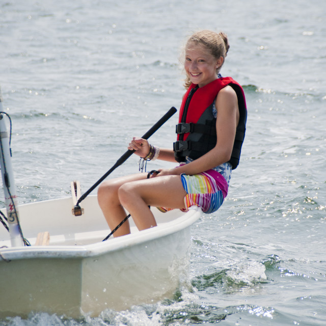 """Young Girl Sailing and Smiling"" stock image"