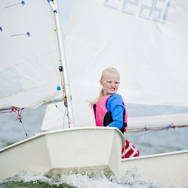 """Young Girl Sailing Intensely"" stock image"
