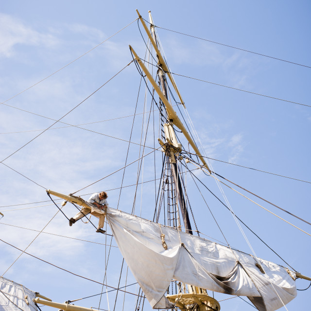 """Man in Ships Rigging"" stock image"