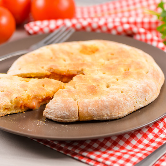 """""""Pizza calzone on wooden background"""" stock image"""
