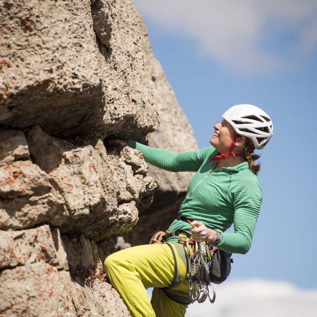 """Woman rock climbing a sport route at Corbet's Couloir in Jackson Hole, Wyoming"" stock image"
