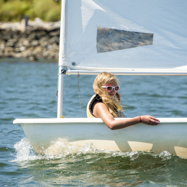 """Young Girl Sailing during Summer"" stock image"