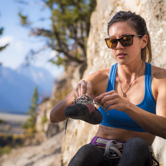 """Athletic Woman preparing to Rock Climb"" stock image"