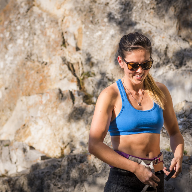 """""""Athletic Woman Laughing before a Rock Climb"""" stock image"""