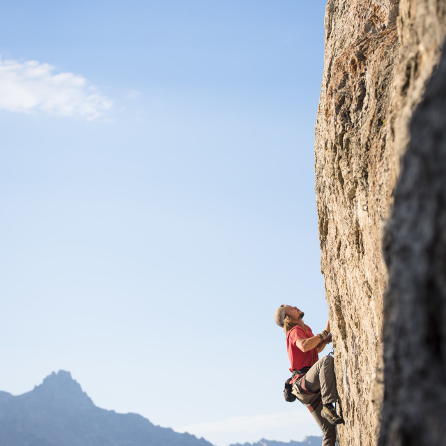 """Young Man Climbing a Sport Route at Blacktail Butte in late Summer"" stock image"
