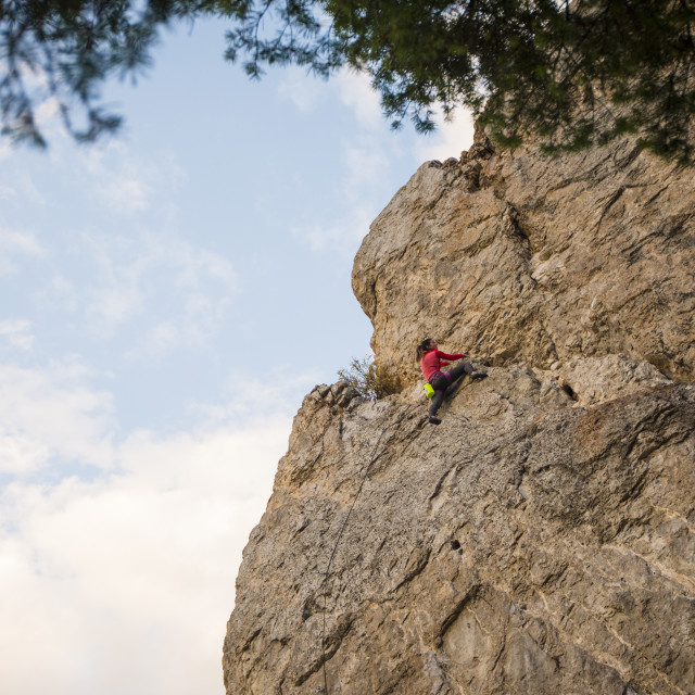 """Athletic Woman Climbing a Sport Route at Blacktail Butte in late Summer"" stock image"
