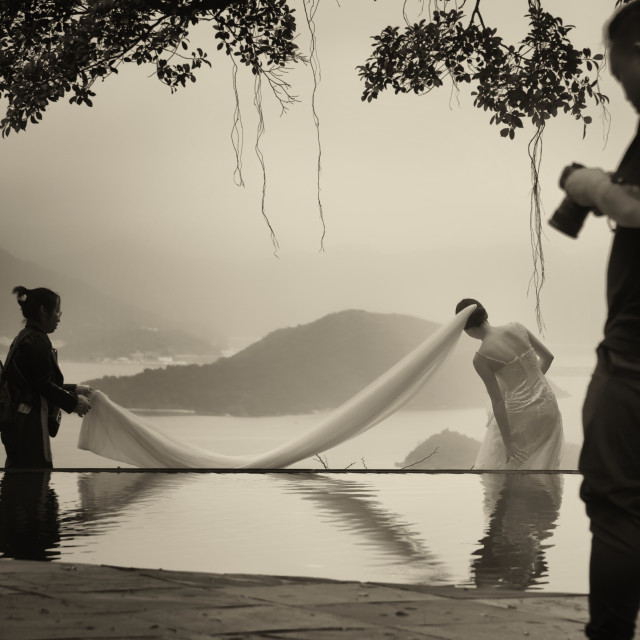 """Happy Bride Behind The Scenes: Infinity Pool"" stock image"