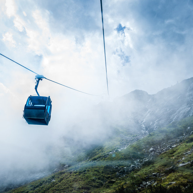 """Cable car in mountain a foggy day"" stock image"