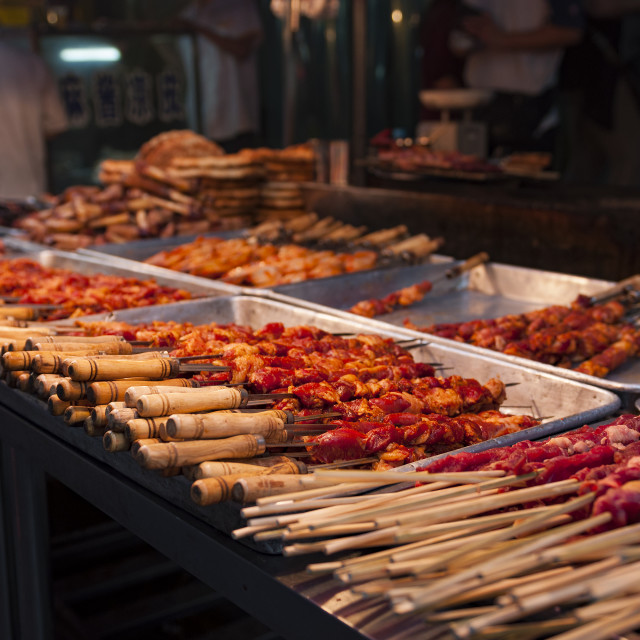 """Detail of lamb kebab in a street market at the Muslim Quarter in the city of Xian, in China."" stock image"