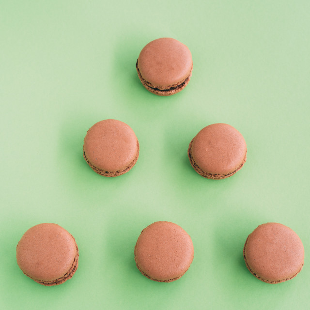 """Flat lay of macaroons on green background"" stock image"