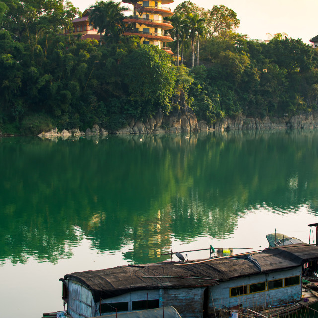 """""""Sunset over a lake in Guangxi province of China"""" stock image"""