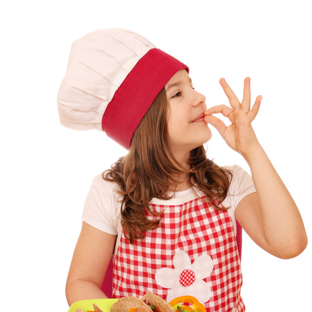 """little girl cook with tacos fast food and ok hand sign"" stock image"