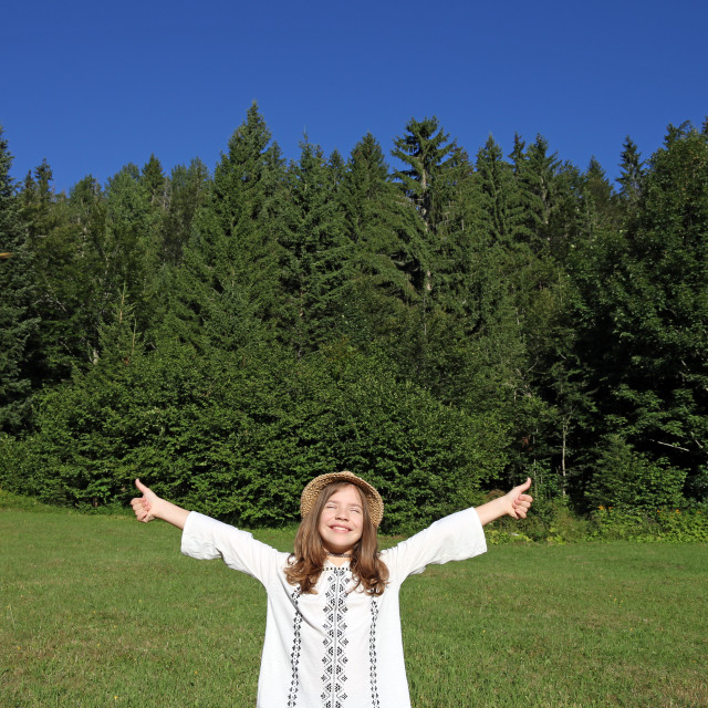 """happy little girl with thumbs up enjoy in nature"" stock image"