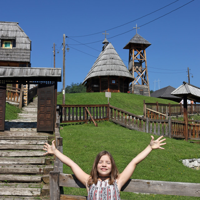 """""""happy little girl with hands up on countryside"""" stock image"""