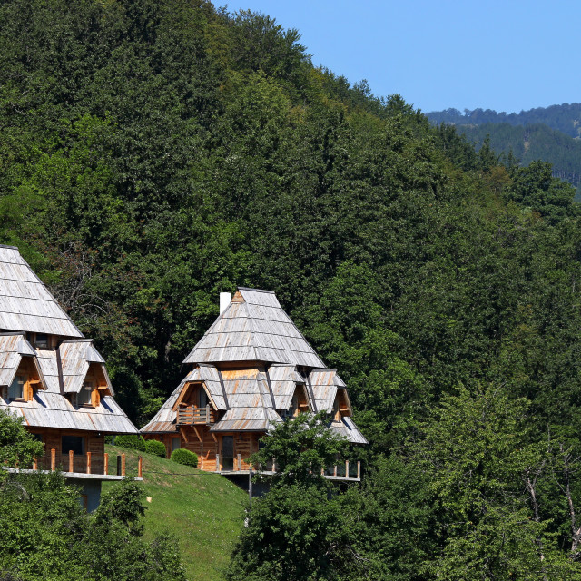 """""""wooden cottages on mountain landscape"""" stock image"""