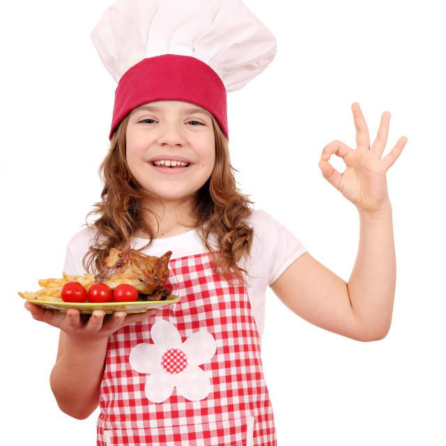 """happy little girl cook with roasted chicken wings and ok hand si"" stock image"