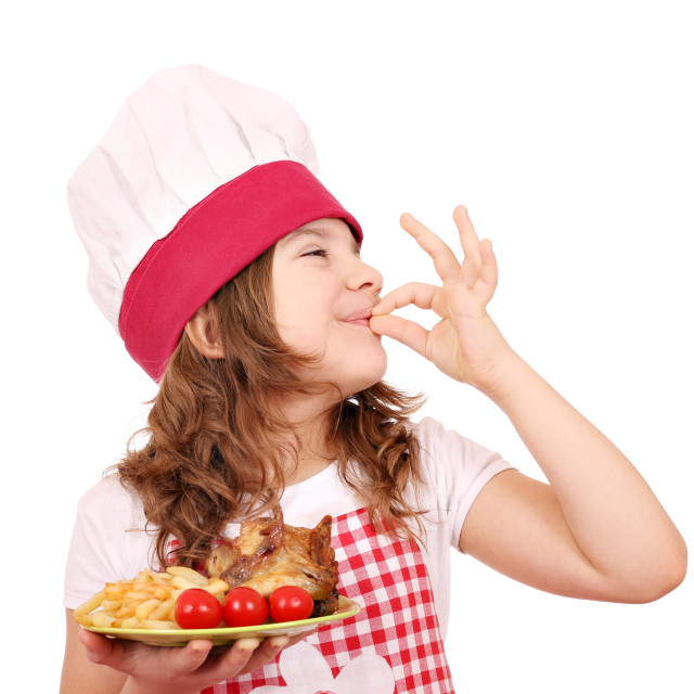 """happy little girl cook with chicken wings and ok hand sign"" stock image"