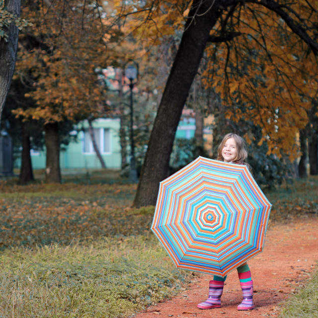 """beautiful little girl with umbrella in park autumn season"" stock image"