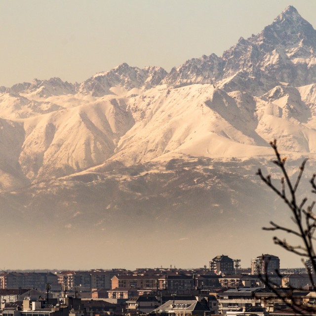 """Monviso mountain towering the city of Turin, Italy."" stock image"