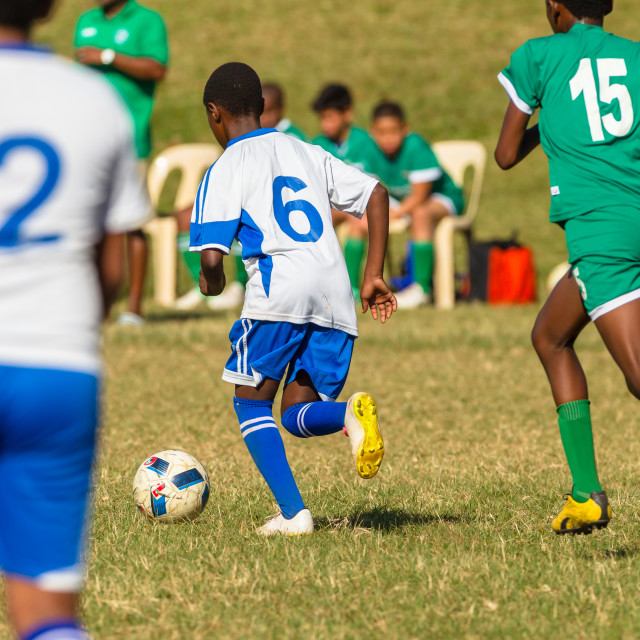 """Football Soccer Junior Players Ball Action"" stock image"
