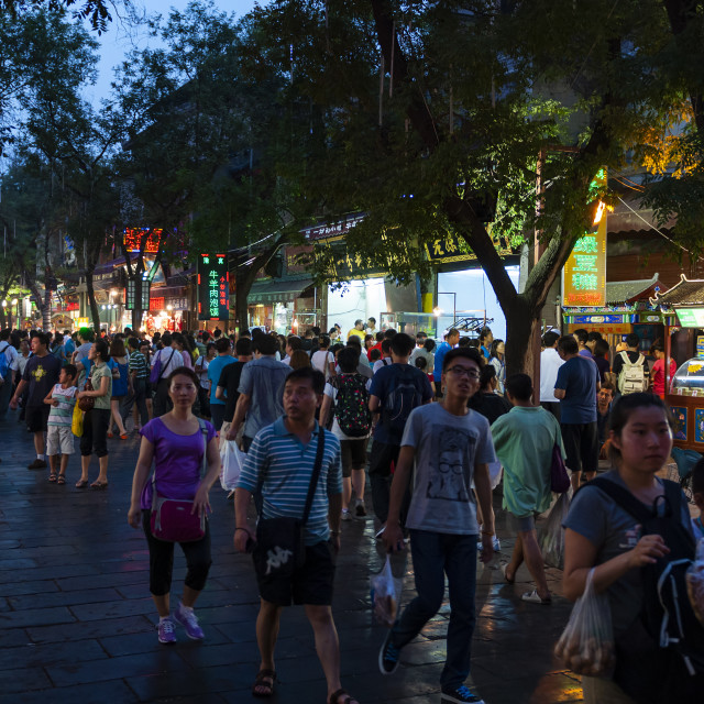 """Xian, China - August 5, 2012: People walking in a street of the Muslim Quarter in the city of Xian at night, in China, Asia"" stock image"