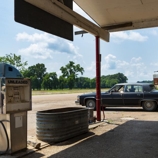 """Sibley, Mississippi - June 21, 2014: Vintage car parkerd at an old gas station along US highway 61, in Sibley, Mississippi, USA."" stock image"