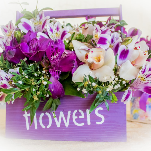 """""""Florist at work: pretty young blond woman making fashion modern bouquet of..."""" stock image"""