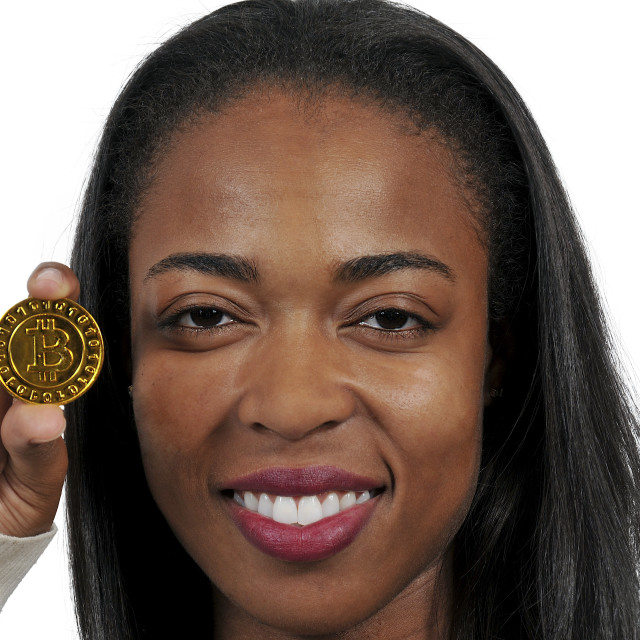 """Woman holding Bitcoin"" stock image"